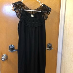 Knee length black dress with lace top